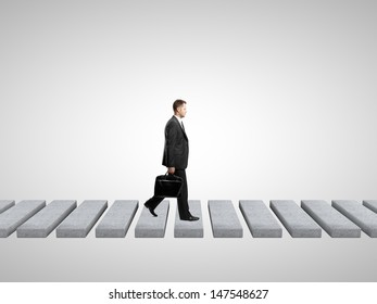 businessman with briefcase on a white background