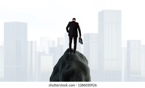 Businessman with briefcase standing on rock and looking at the city