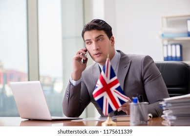 1f59b56c369 Businessman with British flag in the office