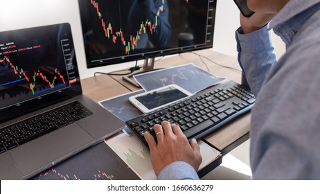 Businessman broker Analyzing finance data graphs and reports on screen for investment purposes for trading graph of stock market