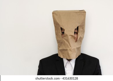 Businessman with brown paper bag on head