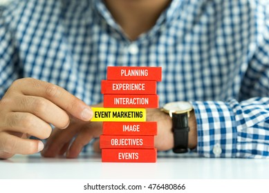 Businessman Building EVENT MARKETING concept with Wooden Blocks