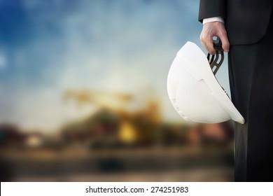 Businessman with building helmet