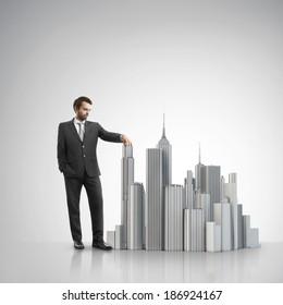 Businessman building model of a city
