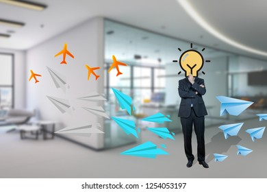 Businessman with bulb instead head in the office as a symbol of idea and concept