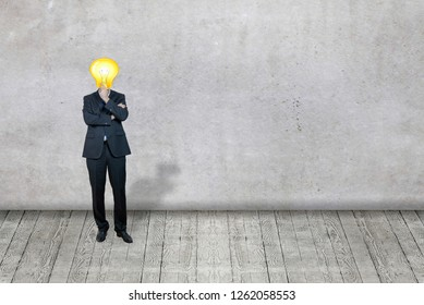 Businessman with bulb instead his head as a symbol of idea
