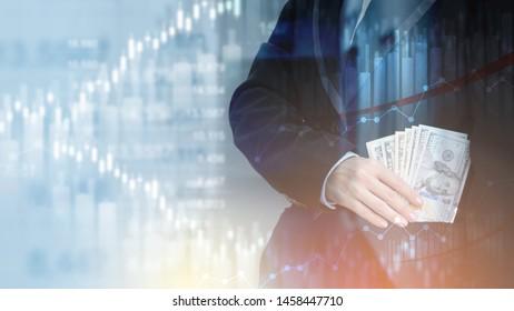Businessman bundle of dollar cash in his hand.