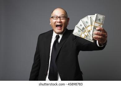 Businessman with bundles of cash.