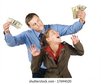 Businessman with bundles of notes is tempting young woman. Isolated on white