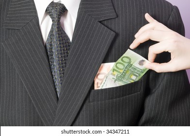 Businessman in business attire with money in the pocket