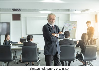 Businessman at business conference meeting. He was smiling and he is a boss who will lead town hall meeting.