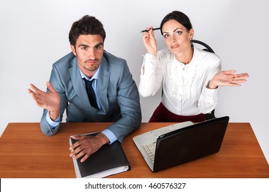 Businessman and business woman sitting at table meeting
