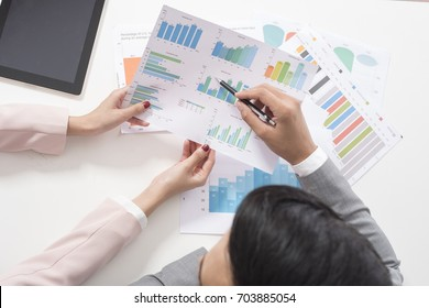 Businessman and businesswoman are analytic graph ,Business plan and business meeting concept