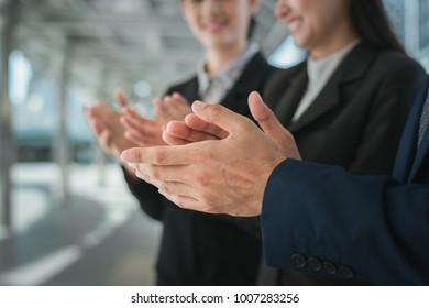 businessman and businesswoman clap their hands to congratulate the signing of an agreement or contract between their companies. concept of success, dealing, greeting and winning.