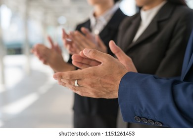 businessman and businesswoman clap their hands to congratulate the signing of contract between their companies. success, greeting and partner concept.