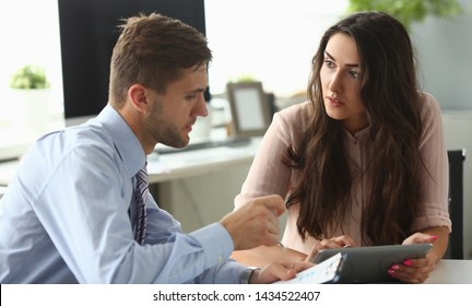 Businessman and businesswoman confer in office. Solve problems and check planned report of financial statistics. One on one meeteng concept.