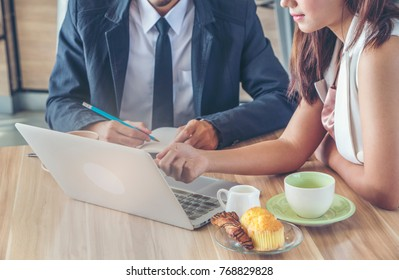 Businessman and businesswoman discussing ideas in the office. Creative professionals gathered at the meeting table for discuss the important issues of the new
