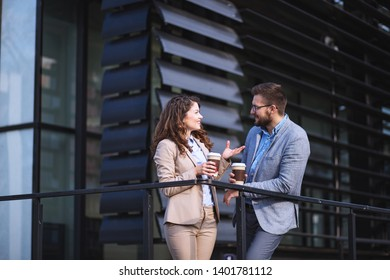 Businessman and businesswoman discussing on a break
