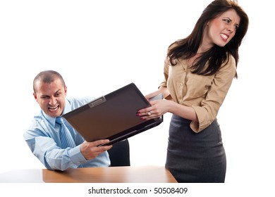 Businessman and businesswoman fighting for a laptop, isolated on white