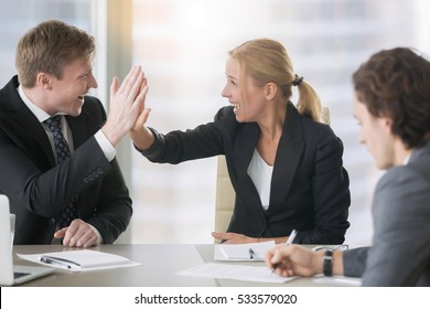 Businessman and businesswoman giving a high five, cheating a man, not safe from frauds, importance of financial literacy, terms and conditions for protecting business, unreliable partner, stay focused