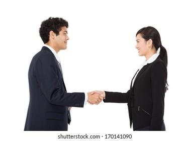 Businessman and businesswoman handshaking.
