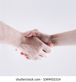Businessman and businesswoman handshaking, studio photo, isolated object, close up of male and female hands shaking, successful deal and partnership, business partners making agreement, forming strong