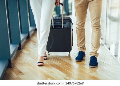 Businessman and businesswoman hold luggage travel to business trip.