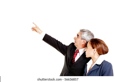 Businessman and businesswoman looking up over white background