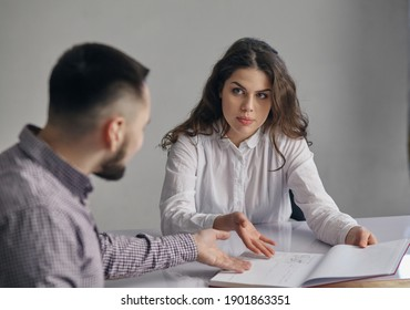 Businessman And Businesswoman Meeting In Office