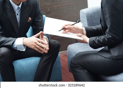 Businessman and Businesswoman Meeting on Sales Pitch