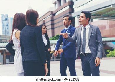 Businessman and Businesswoman meeting project at outdoors. Business people discussion idea. Concept of success teamwork, negotiation, together and collaboration.