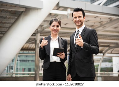 Businessman and businesswoman partner gesture hand thumbsup for trust business.