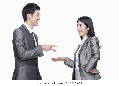 Businessman and businesswoman in playful gesture
