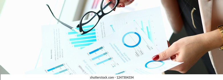 Businessman and businesswoman review graph financial statistics one on one office meeting. Infographic goals objectives planned growth assessment situation segmentation securities market reporting