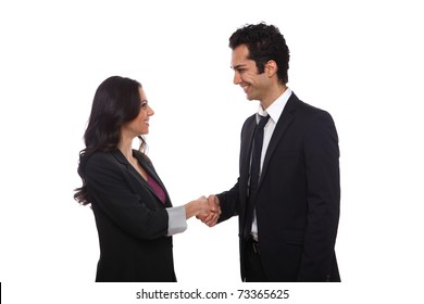 Businessman and businesswoman shaking hands in the studio