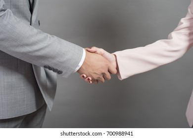 Businessman and businesswoman are shaking hands,Business plan and business meeting concept