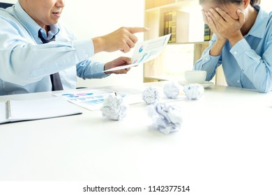 businessman and businesswoman sit quarrel at the table fill sad and headache , concept business failure or problem