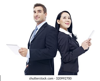 businessman and businesswoman with tablet computer standing back to back, isolated on white background.