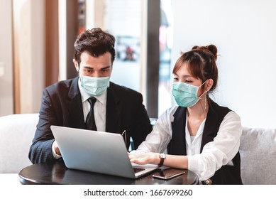 Businessman and Businesswoman Wearing Protective Mask for Protect from Air Pollution, Environmental Awareness and Coronavirus (COVID-19) Outbreak.They Working with Colleagues in an Office