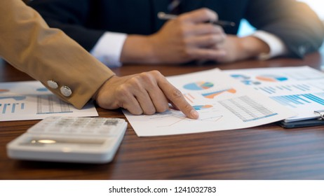 businessman and businesswoman work meeting and consult about the business project use graph chart on the table   ,crop size  16:9