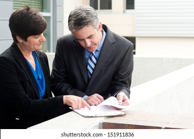 businessman and businesswoman at work outside