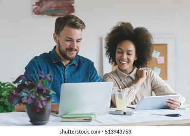 Businessman and businesswoman working together in their office.