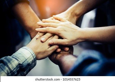 Businessman and Businesswoman,Concept of teamwork: Close-Up of hands business team showing unity with putting their hands together.
