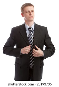Businessman buttons his suit, isolated