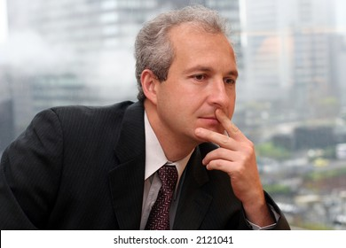 Businessman by the window in his office