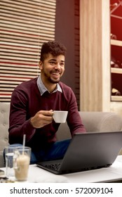 Businessman in a cafe and drink coffee.