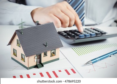 Businessman Calculate The Cost Of Building And Maintaining House. Home  Finance Conception