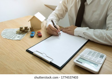 Businessman calculates buy - sale price house . Agent sale home insurance. business concept.