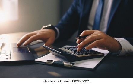 Businessman calculating the financial statement of his business. Accounting and Tax.