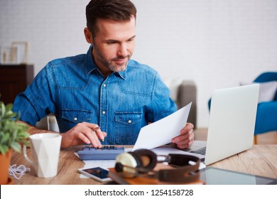 Businessman calculating his monthly expenses